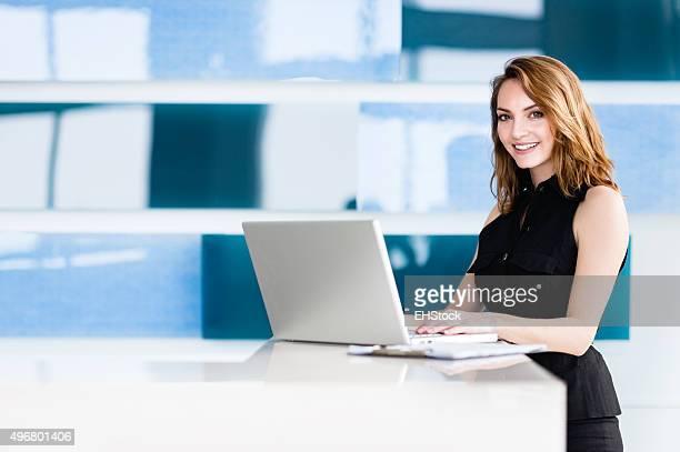 Casual Blonde Businesswoman in Modern Office