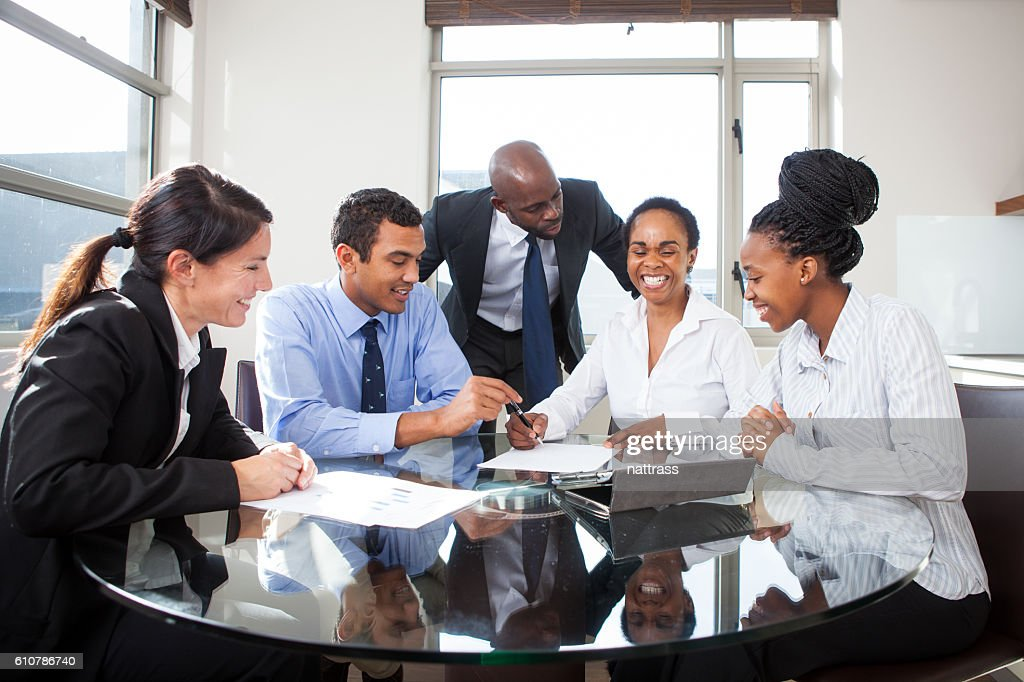 Casual Business Meeting In Office At Round Table : Stock Photo