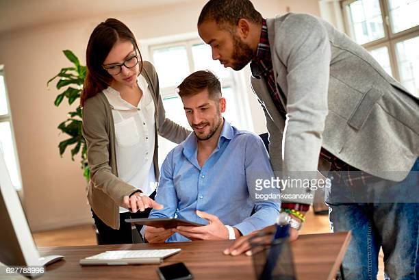 Casual business people with digital tablet