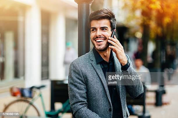 Casual businessman with phone outdoors