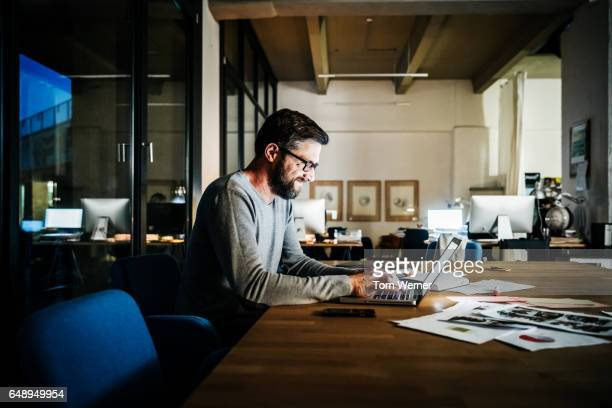 Casual businessman working late on a laptop computer