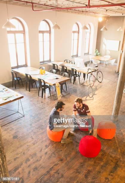 Casual businessmen meeting in open office