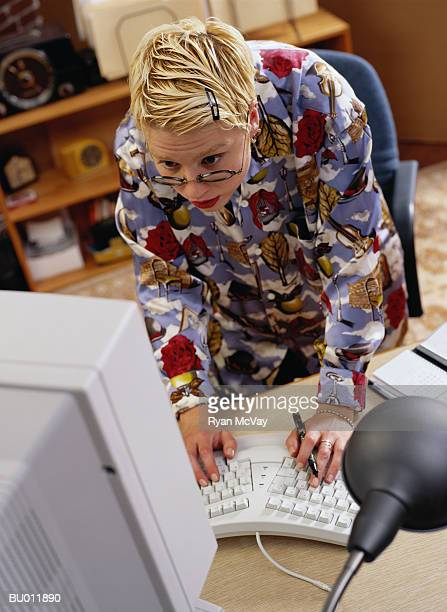 Casual Businesswoman Typing on a Computer