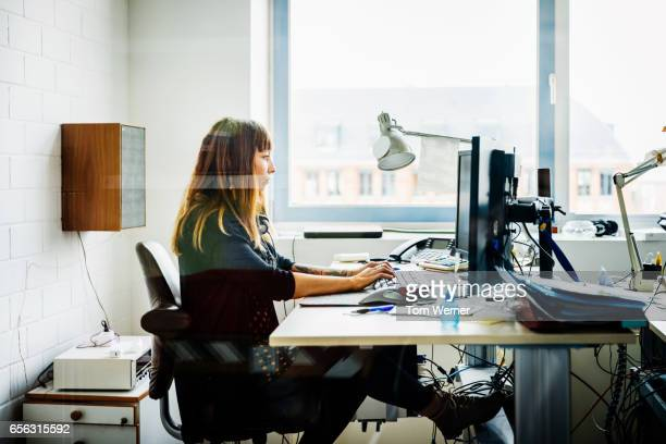 Casual businesswoman working behind her desk