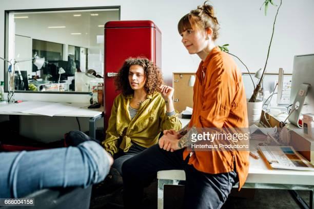 Casual businesswomen brainstorming in office