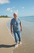 caucasian happy senior man age walking