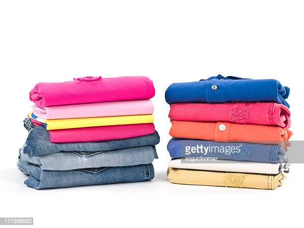 Casual clothes folded in pile on white