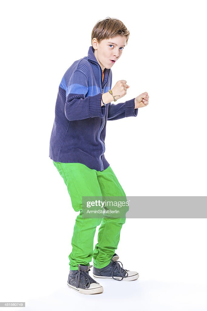 daec669bc249 casual cool teenage boy clenches his fistst, isolated on white : Stock Photo