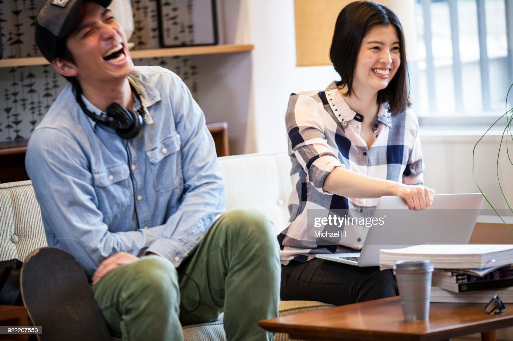 Casual discussion between coworkers at startup office : Stock Photo