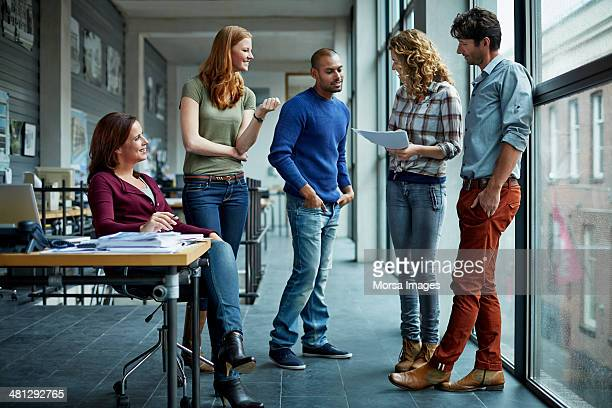 casual discussion between coworkers - five people stock pictures, royalty-free photos & images
