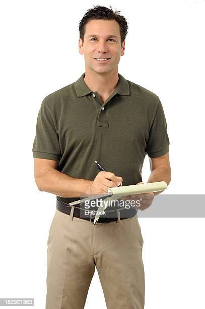 Casual Dress Businessman Writing on Clipboard