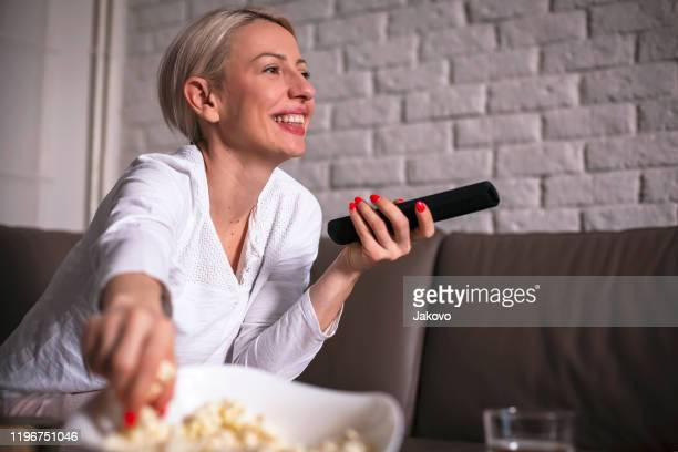 casual evening in front of tv - comedy film stock pictures, royalty-free photos & images