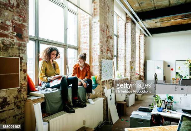Casual female business people having a relaxed informal meeting