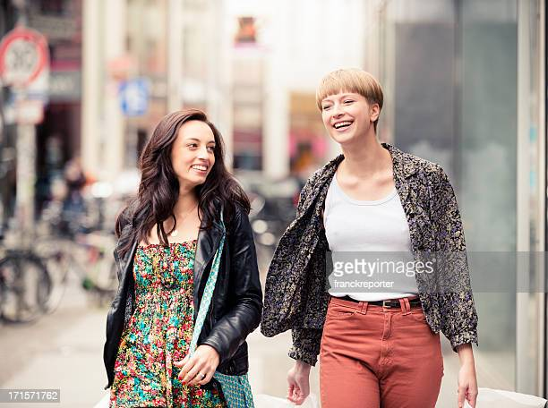 Casual friends walking after shopping