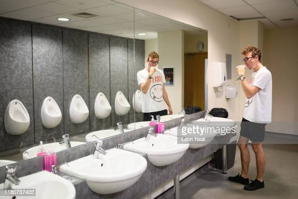 Casual gamer Ben Lawson brushes his teeth in the men's toilets at the beginning of day three of the epicLAN esport tournament at the Kettering...
