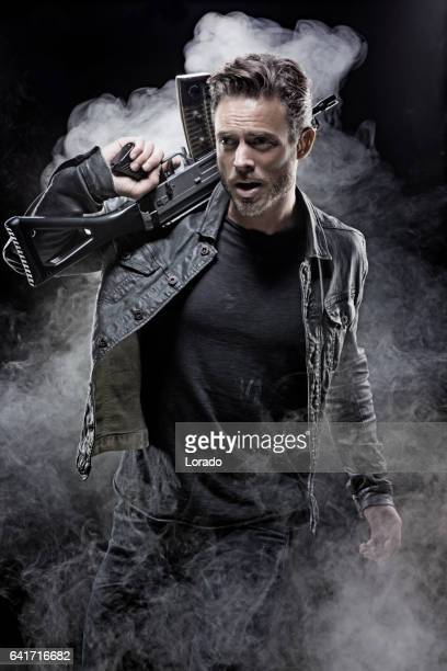 casual gangster man in studio shot - gun stock pictures, royalty-free photos & images