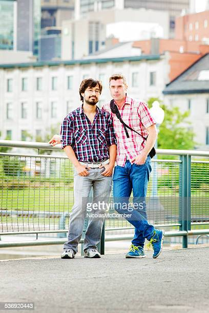 Casual gay couple in Montreal old port portrait full length