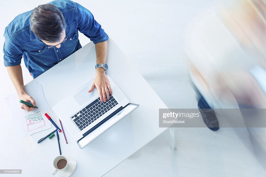 Casual Guy workin on laptop : Stock Photo