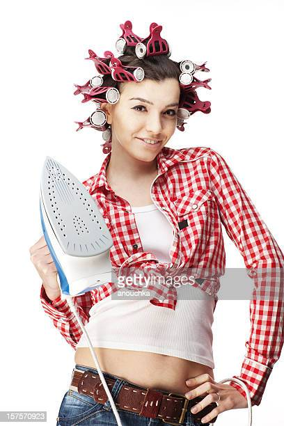 Casual Housewife in Hair Curlers Holding Iron