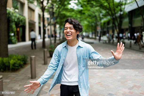 casual japanese man portrait on the street have fun