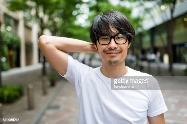 casual japanese man portrait on the street - handsome chinese men stock pictures, royalty-free photos & images