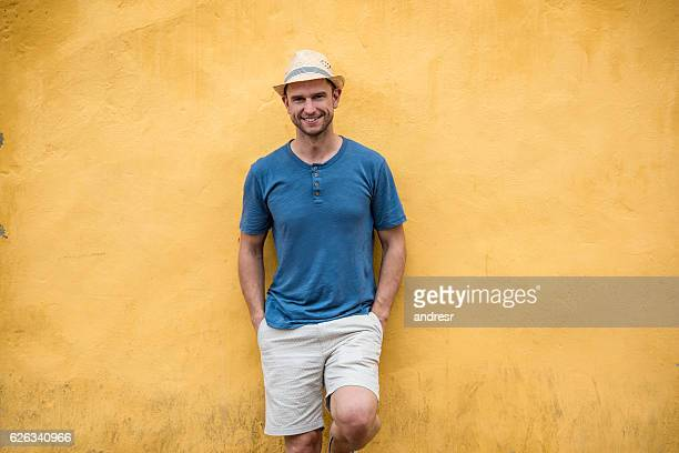 Casual male tourist looking very happy