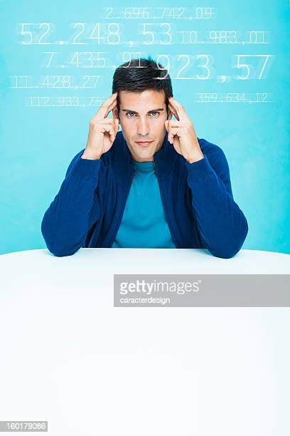 casual man concentrated in calculations - telepathy stock pictures, royalty-free photos & images