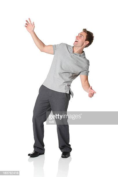 casual man leaning backwards - human arm stockfoto's en -beelden