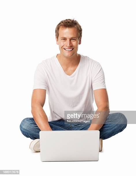 Casual Man Sitting On Floor Using Laptop - Isolated