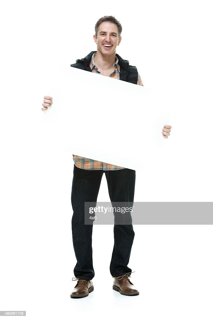 Casual man with placard : Stock Photo