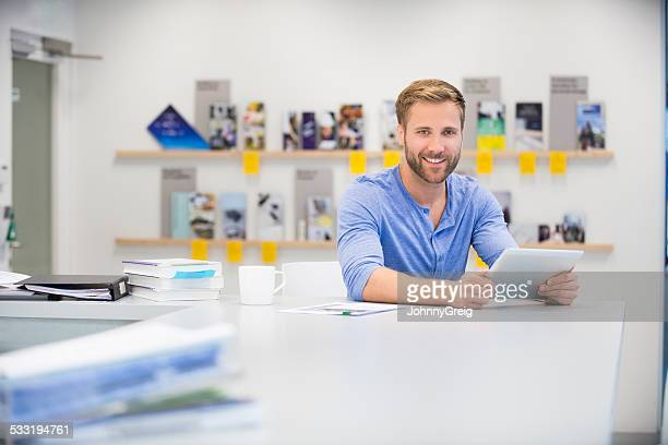 Casual man working on tablet in design studio
