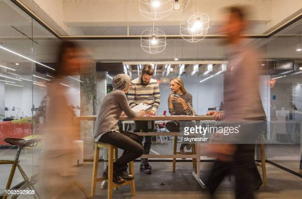 casual meeting at busy corporate office! - motion stock pictures, royalty-free photos & images