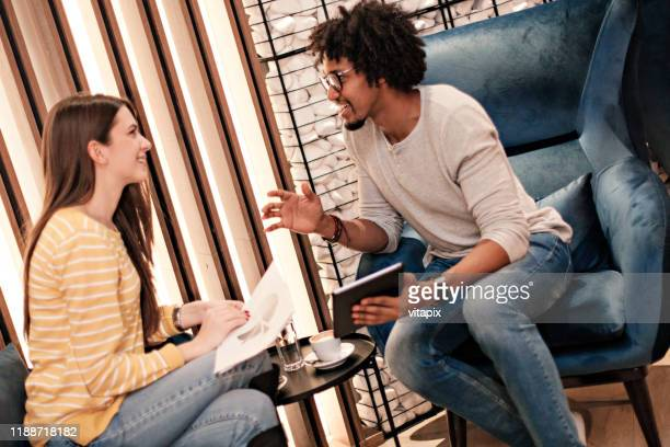 casual meeting - performance stock pictures, royalty-free photos & images
