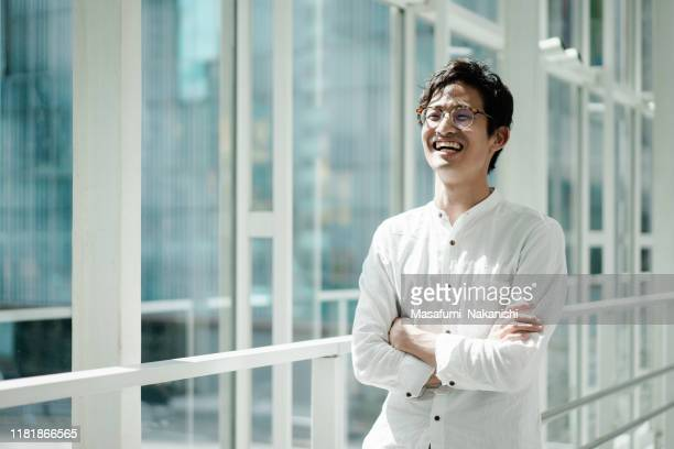 casual portrait of a young asian business person - smart casual stock pictures, royalty-free photos & images