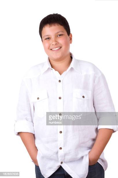 Casual portrait of a young boy smiling with hands in pockets