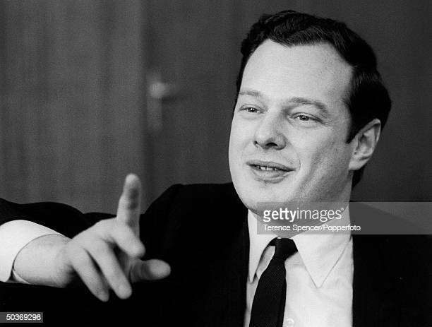 Casual portrait of Brian Epstein manager of the Beatles gesturing during interview