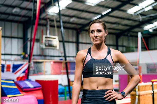 casual portrait of female athlete taking a break at gym - sporting term stock pictures, royalty-free photos & images