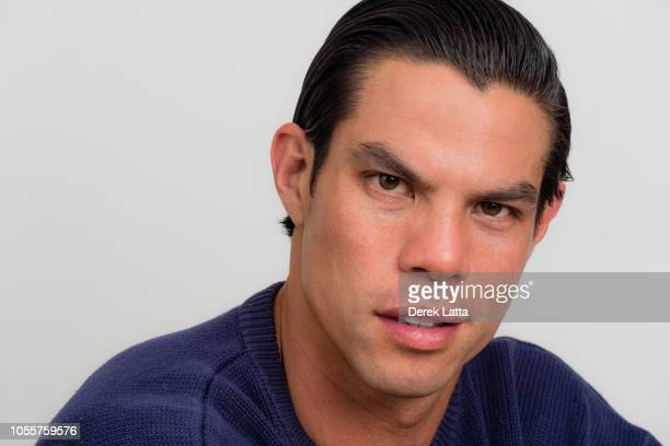 Casual portrait of handsome man in his 30s with confident smile