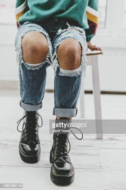 casual portrait of teenager in ripped jeans.Low section