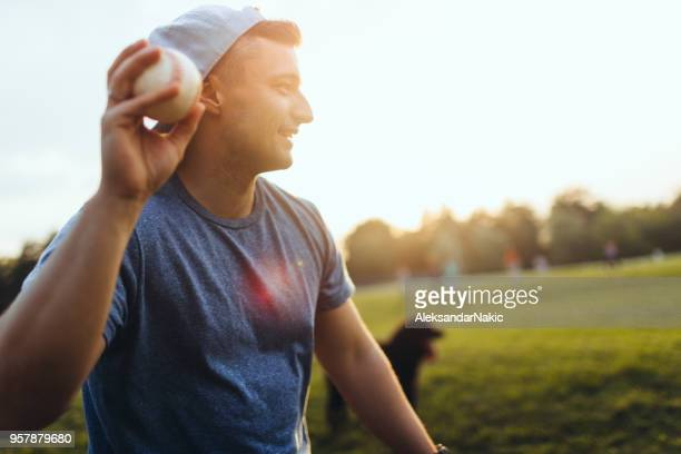 casual softball game outdoors - softball stock pictures, royalty-free photos & images