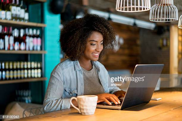 Casual woman working at a cafe