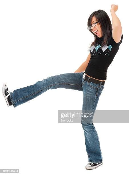 Casual Young Asian Woman Kicking