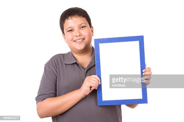 Casual young boy holding blue frame