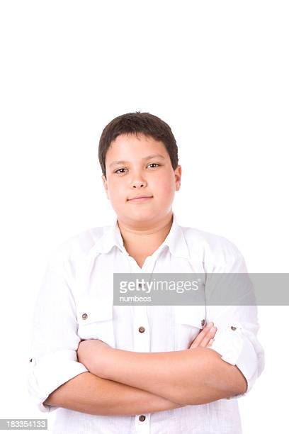 Casual young boy standing against white