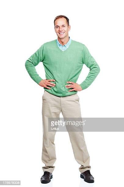 Casual young guy standing isolated against white background