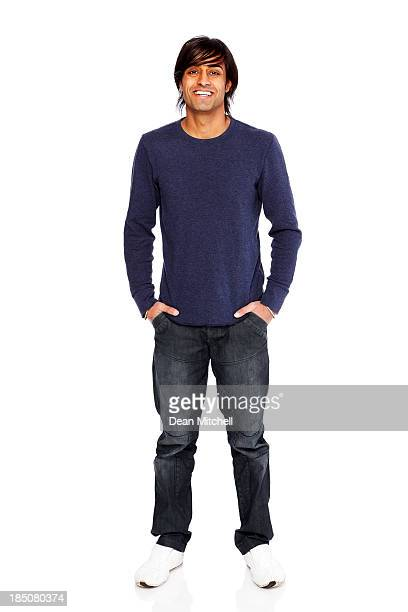 Casual young guy standing on white background