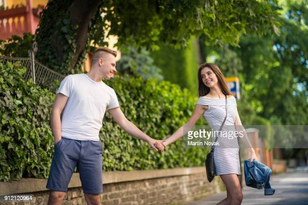 Casual young love couple holding hands