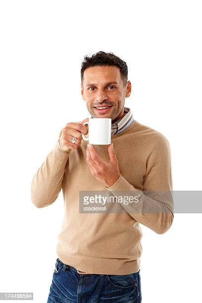 Casual young man having a cup of coffee