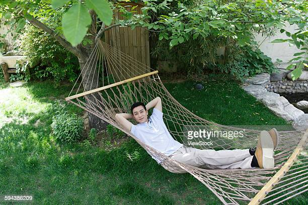 Casual young men lying in a hammock