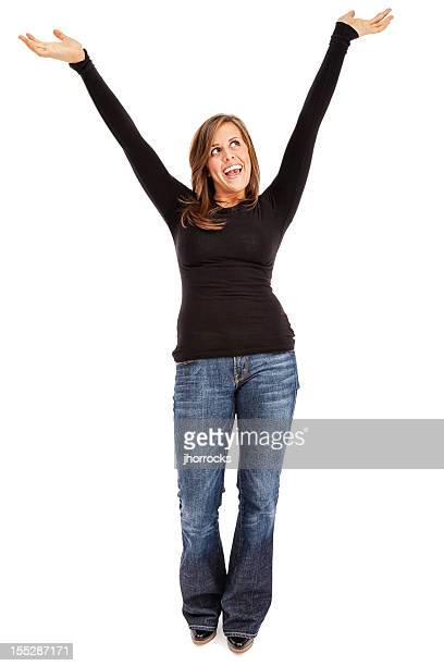 casual young woman cheering with arms raised - zwart shirt stockfoto's en -beelden
